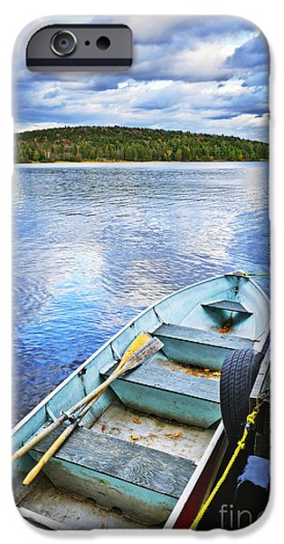 Paddle iPhone Cases - Rowboat docked on lake iPhone Case by Elena Elisseeva