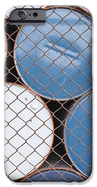 Rows of Stacked Barrels Behind a Fence iPhone Case by Paul Edmondson