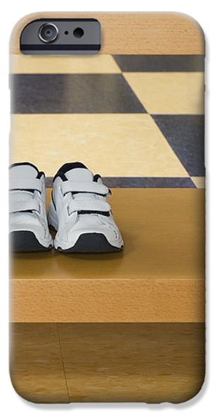 Shoes in a Shelving Unit iPhone Case by Andersen Ross