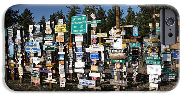 Watson Lake iPhone Cases - Sign posts forest in Watson Lake Yukon iPhone Case by Mark Duffy