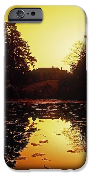 Silhouetted Home And Trees Near Water iPhone Case by The Irish Image Collection