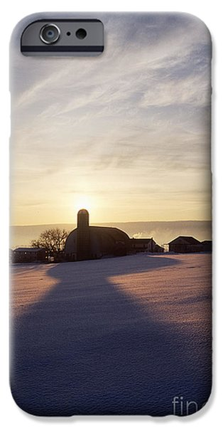Snow Covered Field with Farm Silhouette at Sunset iPhone Case by Jeremy Woodhouse