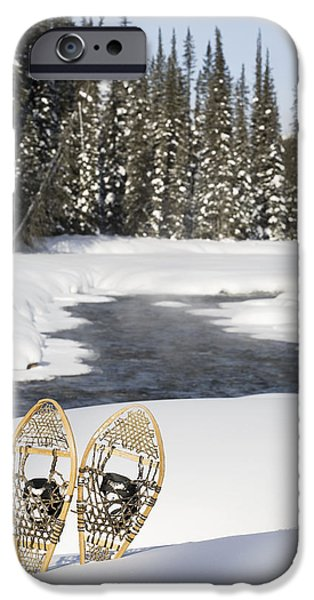 Snowshoes By Snowy Lake Lake Louise iPhone Case by Michael Interisano