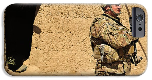 East Village iPhone Cases - Soldier Stands Guard During A Routine iPhone Case by Stocktrek Images
