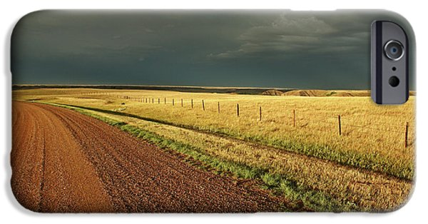 Approaching Storm iPhone Cases - Storm clouds along a Saskatchewan country road iPhone Case by Mark Duffy