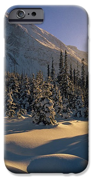 Sun Setting Behind Trees And Mountain iPhone Case by Mike Grandmailson