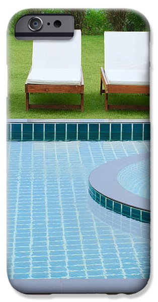 swimming pool and chairs iPhone Case by ATIKETTA SANGASAENG