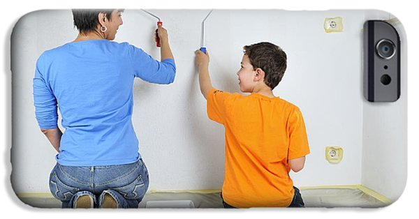 Painter Photographs iPhone Cases - Teamwork - mother and son painting wall iPhone Case by Matthias Hauser