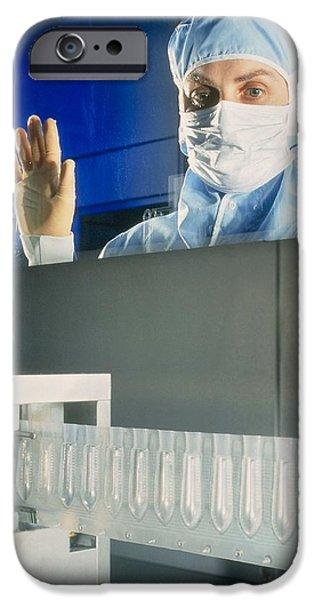 Production Line iPhone Cases - Technician Monitoring Suppository Drug Production iPhone Case by Geoff Tompkinson