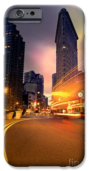 Winter Mornings iPhone Cases - The Flat Iron Building with some magic happening iPhone Case by John Farnan