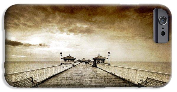 Drama iPhone Cases - the pier at Llandudno iPhone Case by Meirion Matthias
