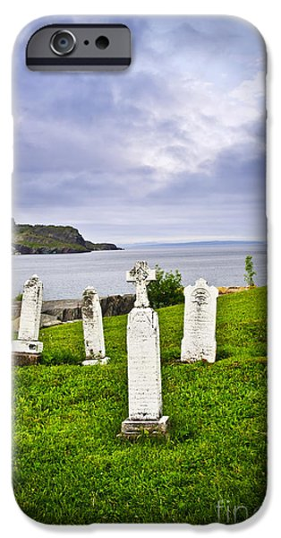 Headstones iPhone Cases - Tombstones near Atlantic coast in Newfoundland iPhone Case by Elena Elisseeva