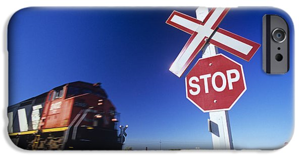 Colour Image iPhone Cases - Train Passing Railway Crossing iPhone Case by Dave Reede