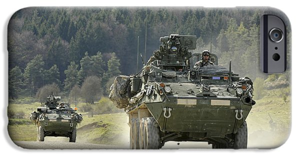 Following iPhone Cases - Two Stryker Vehicles At The Hohenfels iPhone Case by Stocktrek Images