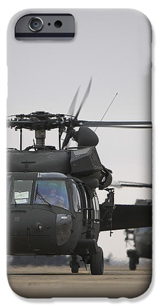 Two Uh-60 Black Hawks Taxi iPhone Case by Terry Moore