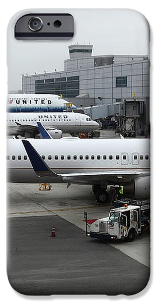 United Airlines At Foggy SFO International Airport . 5D16937 iPhone Case by Wingsdomain Art and Photography