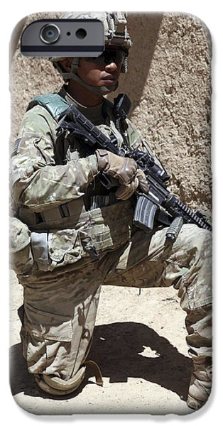 East Village iPhone Cases - U.s. Army Soldier Takes A Knee While iPhone Case by Stocktrek Images