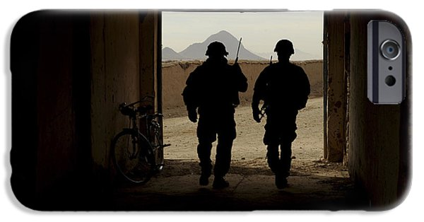 East Village iPhone Cases - U.s. Army Soldiers Patrol A Village iPhone Case by Stocktrek Images