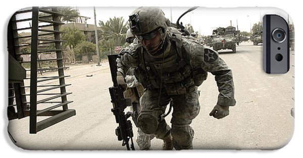 Baghdad iPhone Cases - U.s. Army Specialist Entering A Stryker iPhone Case by Stocktrek Images