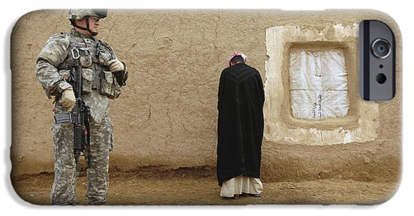 East Village iPhone Cases - U.s. Army Specialist Guards An Iraqi iPhone Case by Stocktrek Images