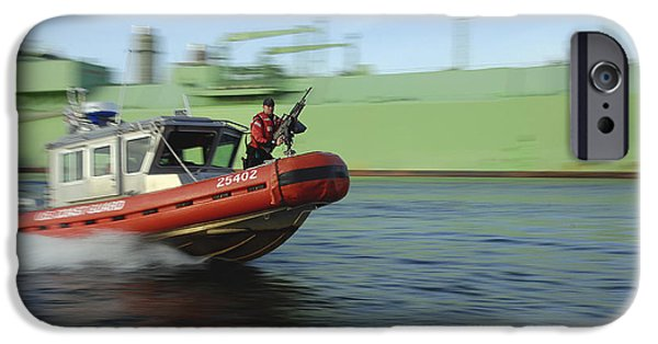 Law Enforcement iPhone Cases - U.s. Coast Guard Officer Mans A M240b iPhone Case by Stocktrek Images