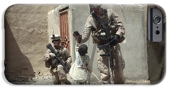 East Village iPhone Cases - U.s. Marine Gives An Afghan Child iPhone Case by Stocktrek Images
