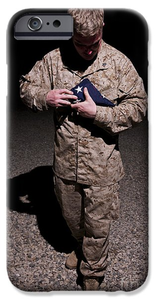 Man Looking Down iPhone Cases - U.s. Marine Holding The American Flag iPhone Case by Terry Moore