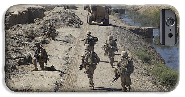 East Village iPhone Cases - U.s. Marines Conduct A Security Patrol iPhone Case by Stocktrek Images