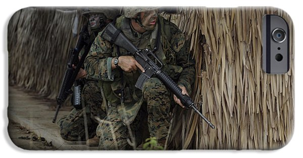 Bamboo House iPhone Cases - U.s. Marines Prepare To Enter A House iPhone Case by Stocktrek Images