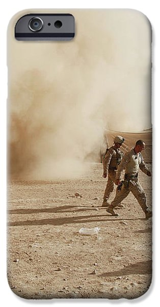 U.s. Marines Walk Away From A Dust iPhone Case by Stocktrek Images