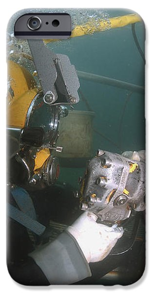 U.s. Navy Diver Uses A Grinder To File iPhone Case by Stocktrek Images