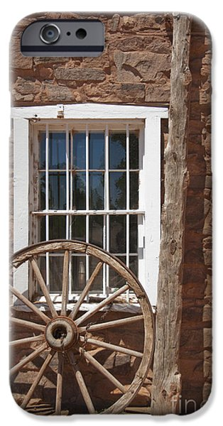 Historic Site iPhone Cases - Window in Stone Building With Wagon Wheel iPhone Case by Thom Gourley/Flatbread Images, LLC