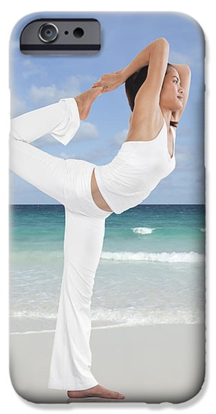 Pilate iPhone Cases - Woman doing yoga on the beach iPhone Case by Setsiri Silapasuwanchai