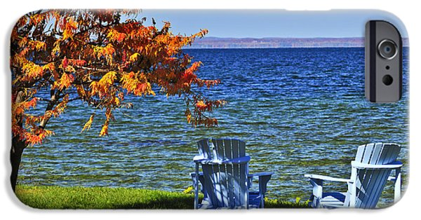 Calmness iPhone Cases - Wooden chairs on autumn lake iPhone Case by Elena Elisseeva