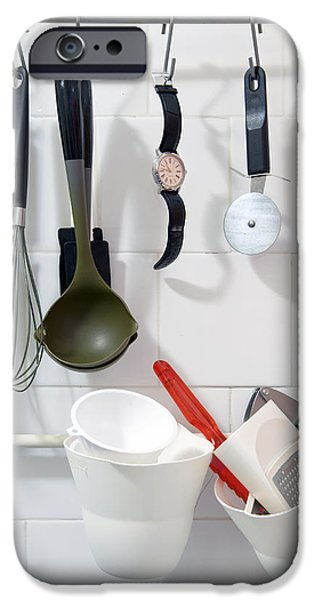 Wrist Watch Hanging Amongst Various iPhone Case by Corepics