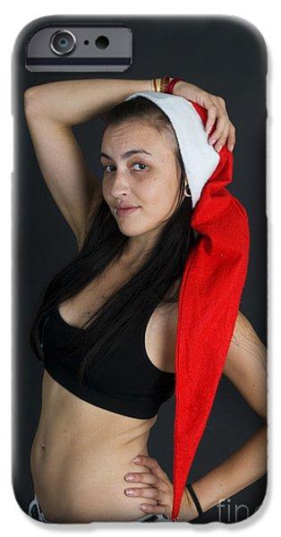 Young woman wearing Santa hat iPhone Case by Ilan Rosen