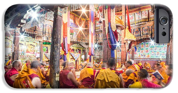 Tibetan Buddhism iPhone Cases - Buddhist monks praying in Thiksay monastery iPhone Case by Didier Marti
