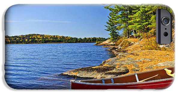 Paddle iPhone Cases - Canoe on shore iPhone Case by Elena Elisseeva