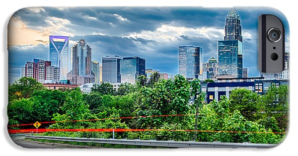Drama iPhone Cases - Downtown of Charlotte  North Carolina skyline with dramatic sky iPhone Case by Alexandr Grichenko