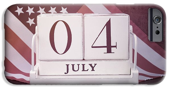 Independance Day Photographs iPhone Cases - Fourth of July vintage wood calendar with flag background.  iPhone Case by Milleflore Images