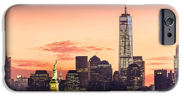 Finance iPhone Cases - Lower Manhattan and the Statue of Liberty at sunrise iPhone Case by Mihai Andritoiu