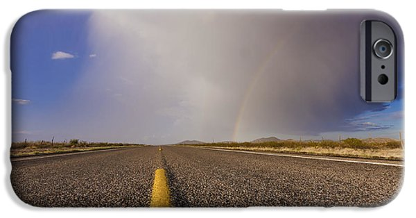 Ground Level iPhone Cases - Storm and Rainbow Along the Highway iPhone Case by Jeremy Woodhouse