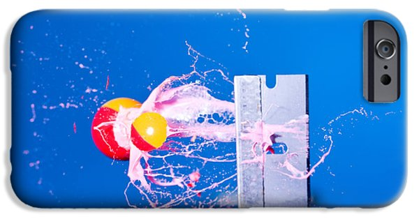 High Speed Photography iPhone Cases - Paintball Shot At Razor Blade iPhone Case by Ted Kinsman
