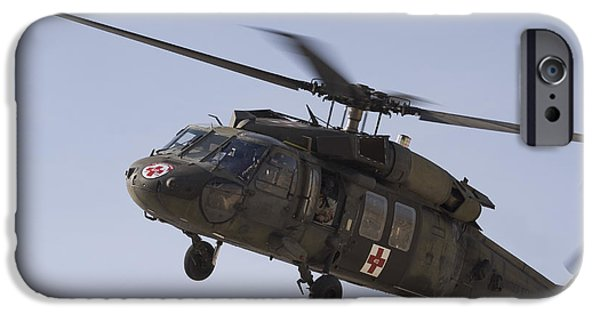 Iraq iPhone Cases - A Uh-60 Blackhawk Medivac Helicopter iPhone Case by Terry Moore
