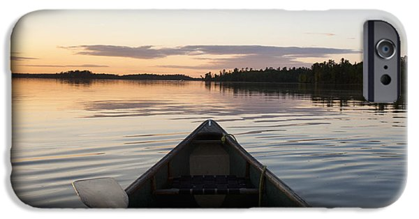 Canoe iPhone Cases - A Boat And Paddle On A Tranquil Lake iPhone Case by Keith Levit