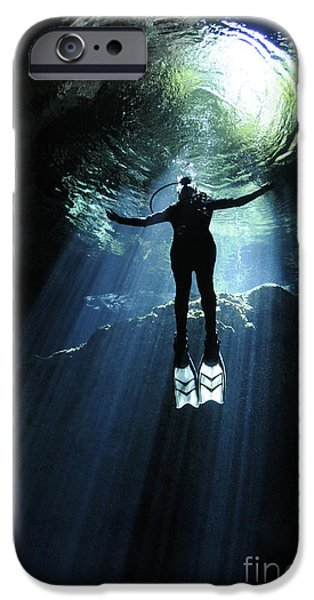 Cavern iPhone Cases - A Cavern Diver Ascends In The Cenote iPhone Case by Karen Doody