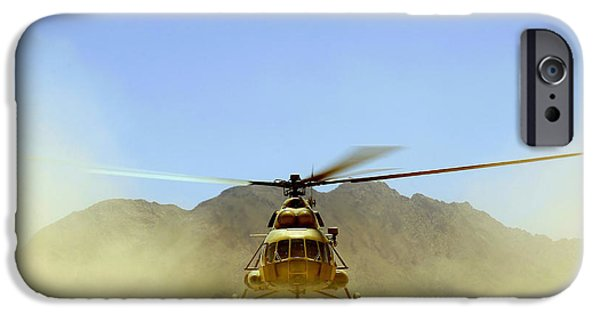 Afghanistan iPhone Cases - A Mi-17 Hip Helicopter Hovers iPhone Case by Stocktrek Images