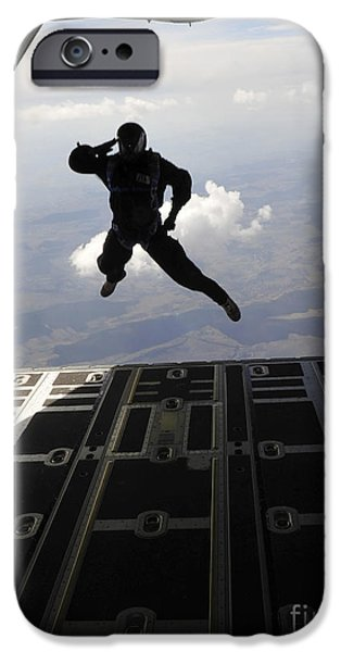 Adults Only iPhone Cases - A Paratrooper Salutes As He Jumps iPhone Case by Stocktrek Images