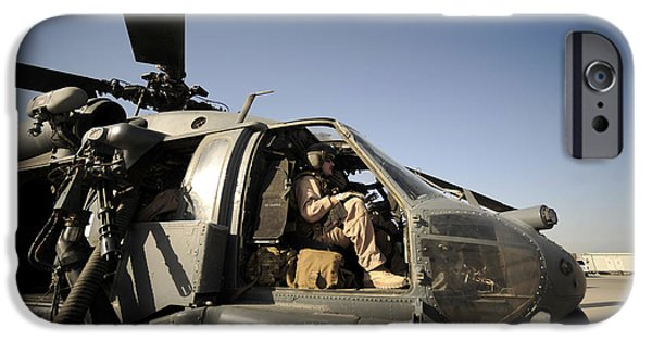 Iraq iPhone Cases - A Pilot Sits In The Cockpit Of A Hh-60g iPhone Case by Stocktrek Images