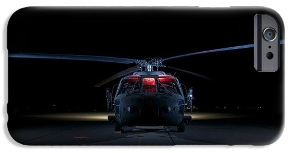 Iraq iPhone Cases - A Uh-60 Black Hawk Helicopter Lit iPhone Case by Terry Moore